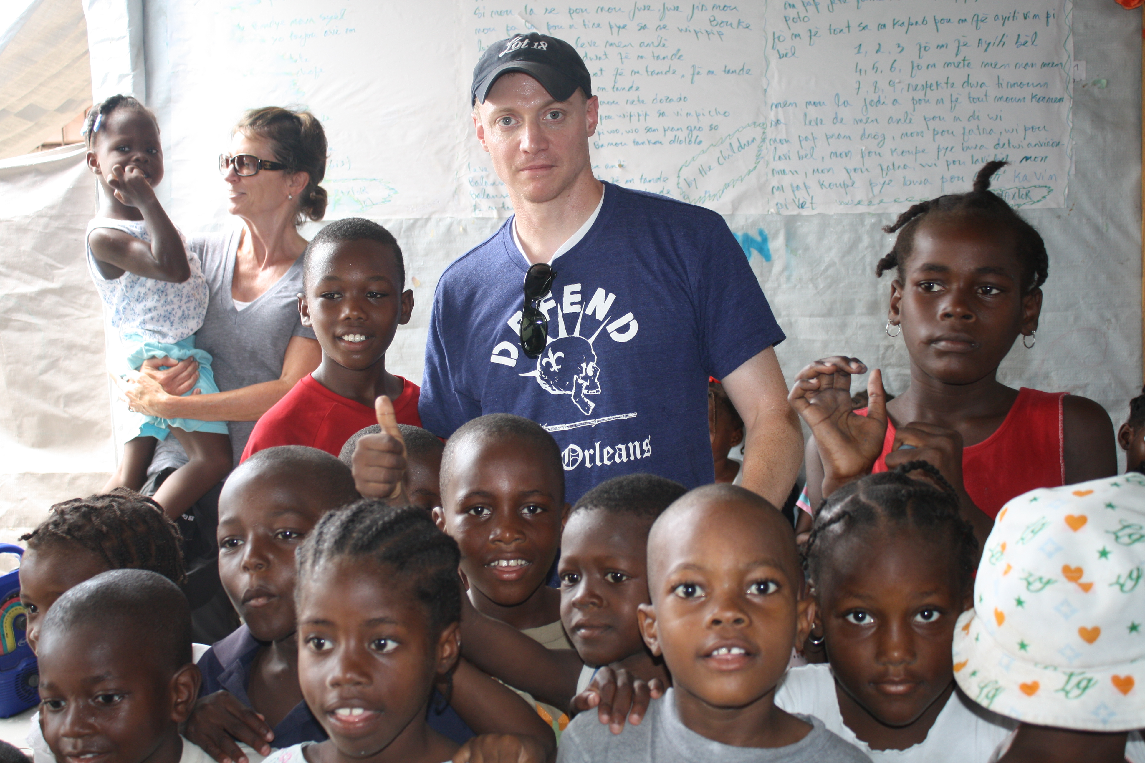 Fortuna, center in hat, visiting Concern's relief efforts in Haiti. (Courtesy Kevin Fortuna)