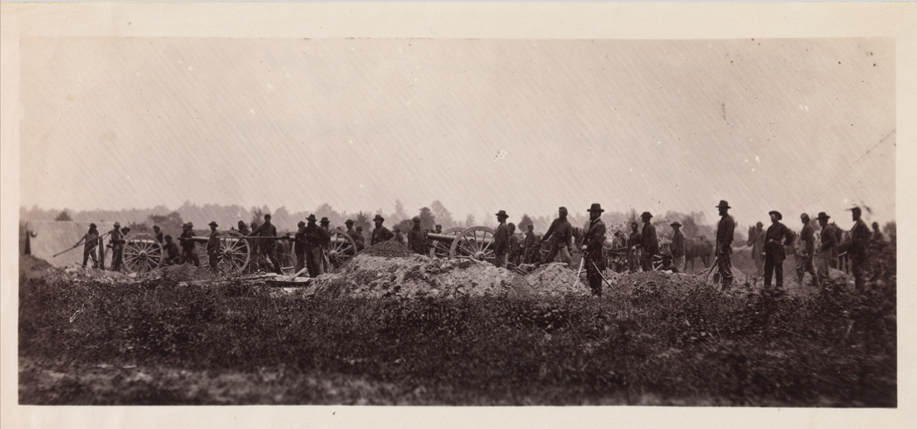"""Timothy O'Sullivan's """"Pennsylvania Light Artillery, Battery B, Petersburg, Virginia,"""" which is one of the few """"action"""" shots of the Civil War."""