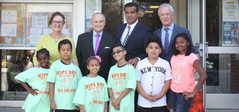 Colleen Kelly, former NYPD Commissioner Raymond  Kelly, Kips Bay Boys and Girls Club Executive  Director Dan Quintero, Ed Kelly and members of the Kips Bay Boys and  Girls Club at the check  presentation.