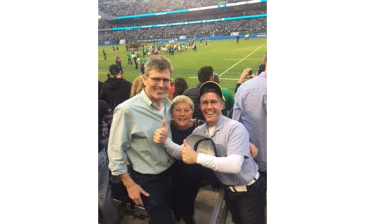 Wall Street 50 honoree Martin Kehoe with his wife Mary and Healthcare 50 honoree Neil Kelleher at the Ireland – New Zealand game at Soldier Field