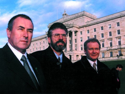 McGuinness outside the Parliament Building, Stormont, Belfast, with Gerry Adams and Sinn Féin Party Chairman, Mitchel McLaughlin, November 1999