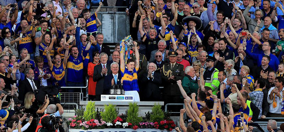 "Brendan Maher, captain Tipperary Senior Hurling team, lifts the McCarthy cup following  the team's All-Ireland final triumph over the  Kilkenny ""Cats"" by 2-15 to 2-08. Goals were scored by John ""Bubbles"" O'Dwyer and John McGrath, while Seamus Callanan contributed 13 points. (Photo: RTÉ)"