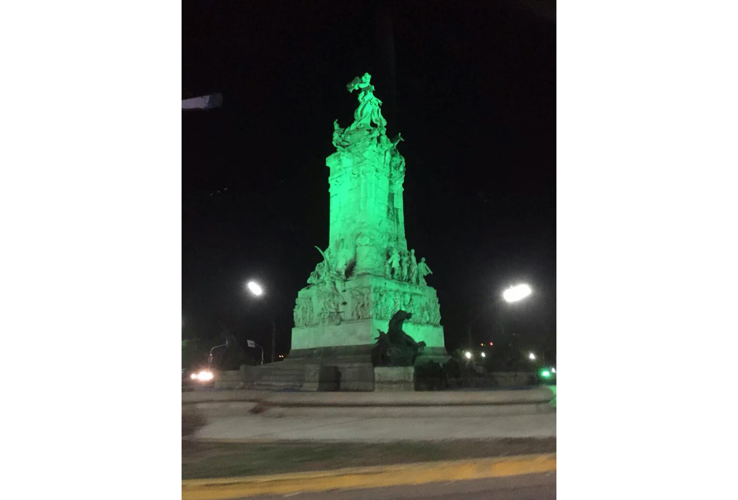 The Spanish Monument in Buenos Aires, raised in 1910 for the  centennial of Argentina's Revolution of May, illuminated green for Ireland's own centenary.