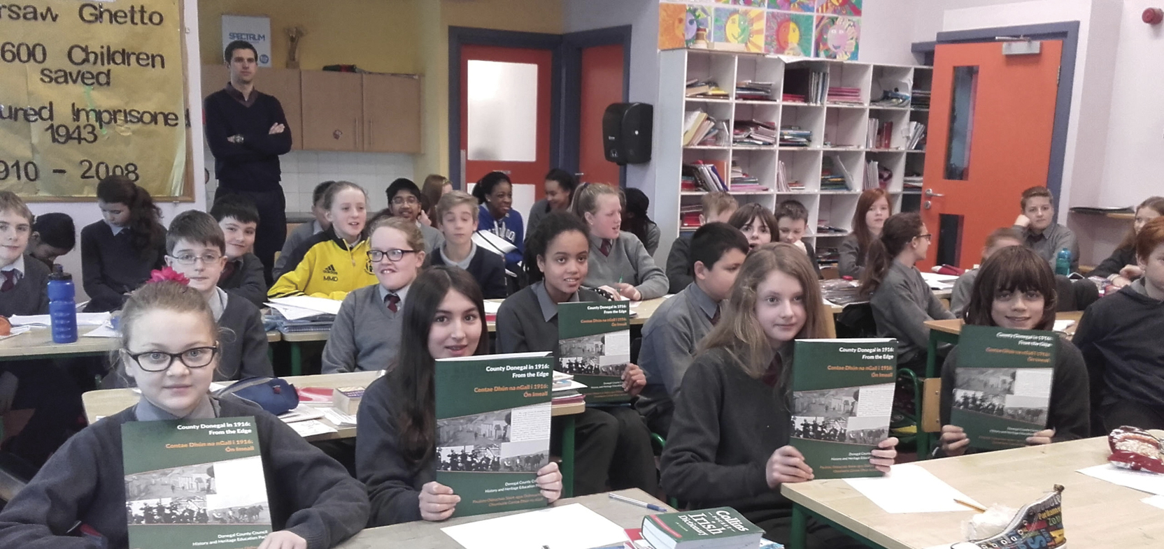 Children from  Illistrin National School receive copies of County Donegal in 1916: From the Edge, History and Heritage Education Pack, February 2016. (Photo: Eileen Burgess)