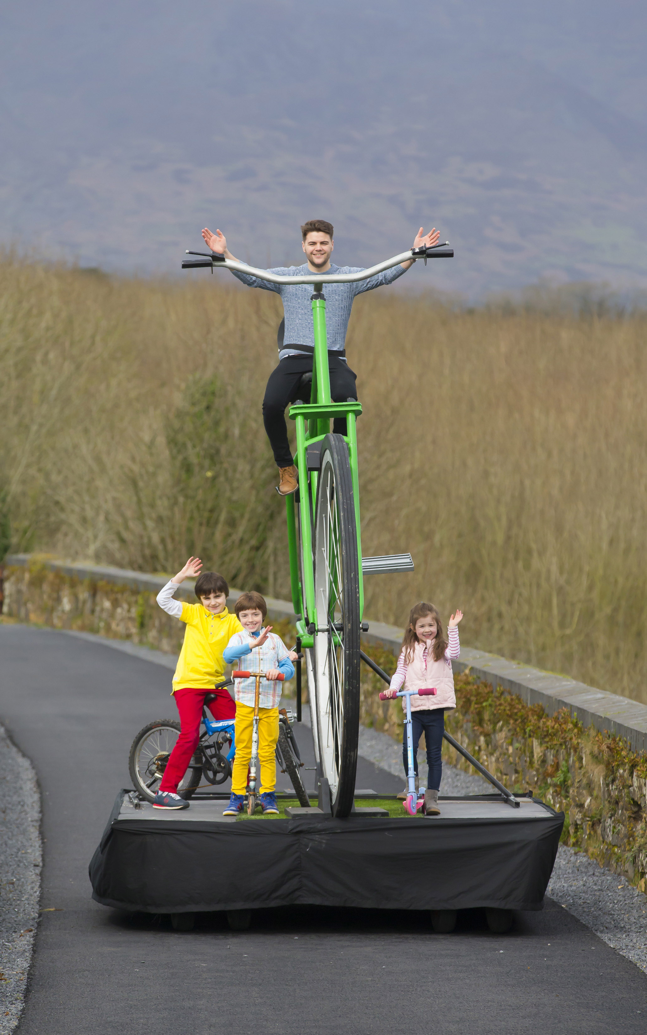 Pictured on the Waterford Greenway is Mayor of Waterford, Cllr Adam Wyse on a giant bicycle created by street arts company Buí Bolg along with Joshua Moran-Davy (10), Reuben Moran-Davy (7) and Leah Moran-Saunders (5) from Passage East, Co Waterford. (Picture: Patrick Browne)