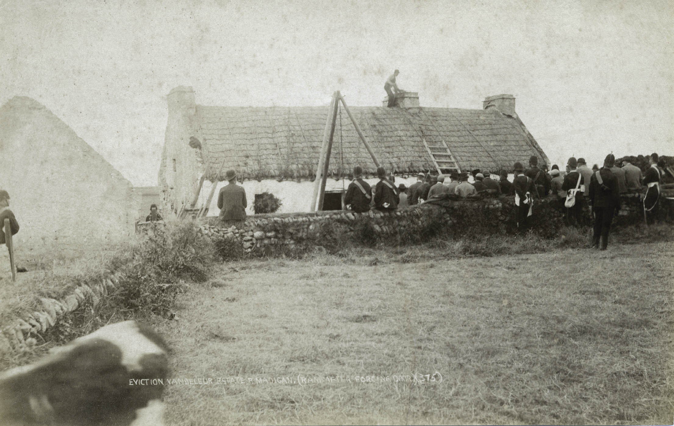 Uniformed British police perform an eviction on the Vandeleur Estate, c. 1888.