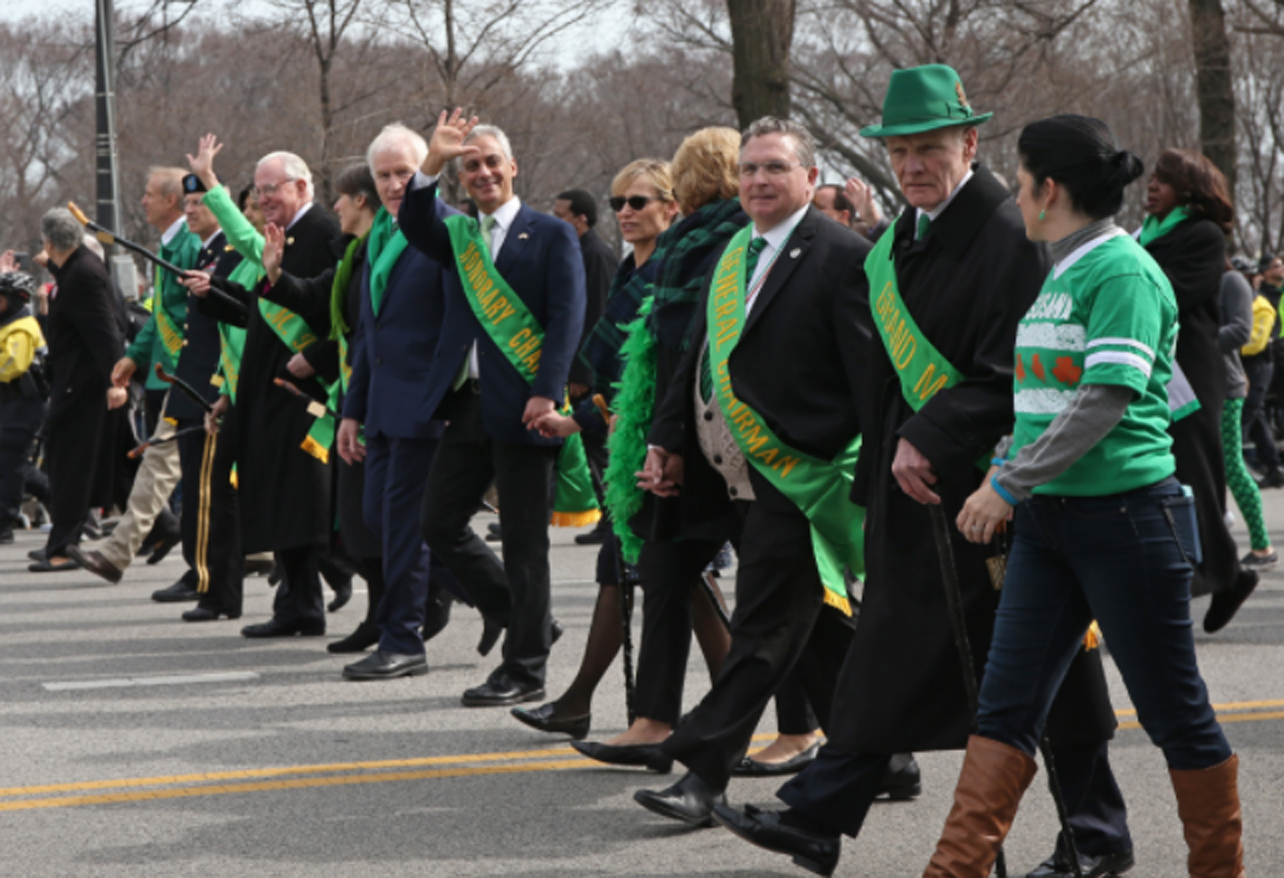 Chicago Mayor Rahm Emanuel (top, center left, waiving) marches in the 2016 Chicago St. Patrick's Day Parade.
