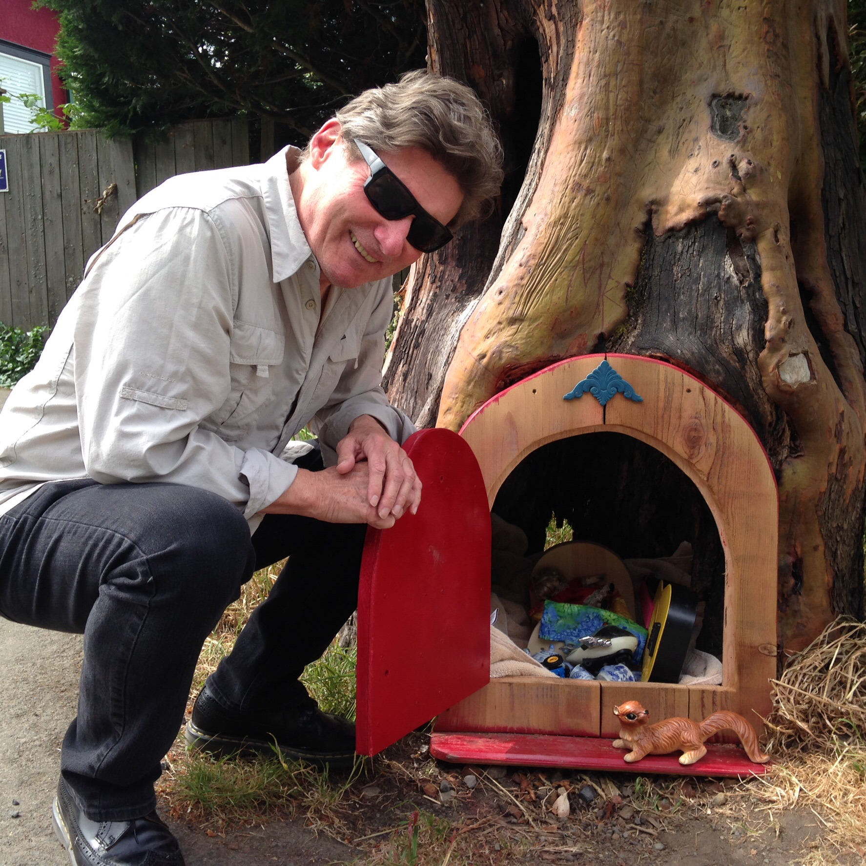 Roger Brunt with an example of one of the fairy doors on Salt Spring Island.