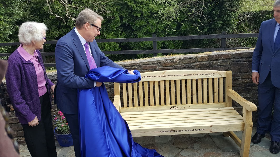 Bill Ford and distant relative Hazel Ford Buttimer reveal the commemorative bench.