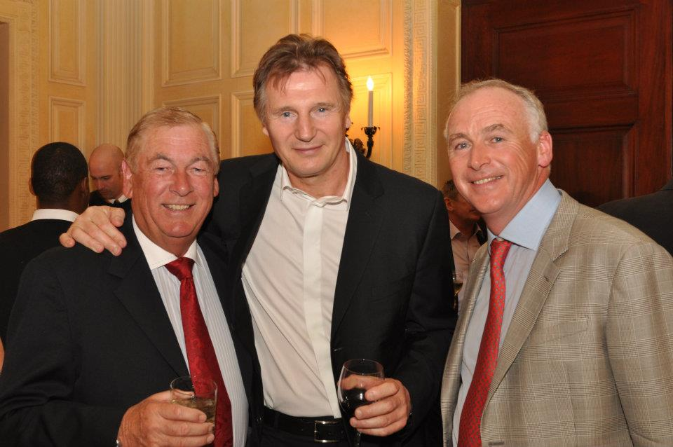 Liam Neeson (center) attends the 2012 tournament. John Fitzpatrick is pictured at right.