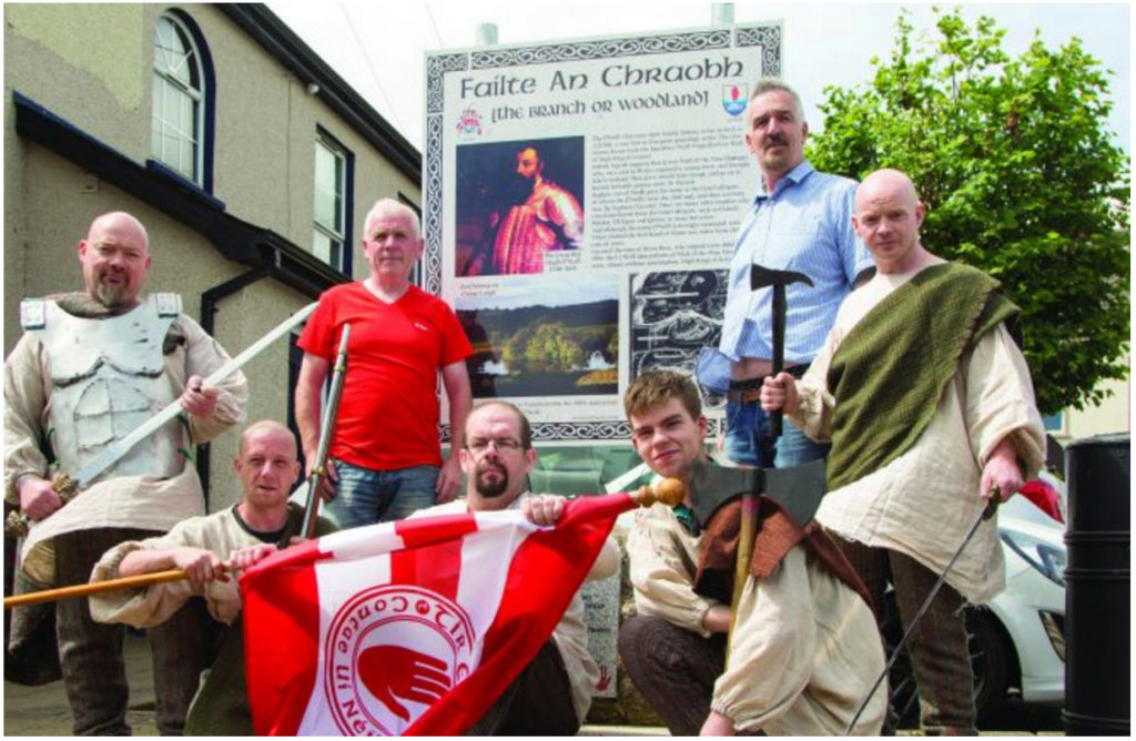 Members of  the local historical  reenactment group  with Dan O'Neill, chief guardian of the Ancient Clan of O'Neill in  Ulster, and the chairman of Stewartstown  Community Group Johnny Rushe, who  unveiled a memorial stone and plaque for  the 400th anniversary  of the death of Hugh O'Neill in The Square, Stewartstown.