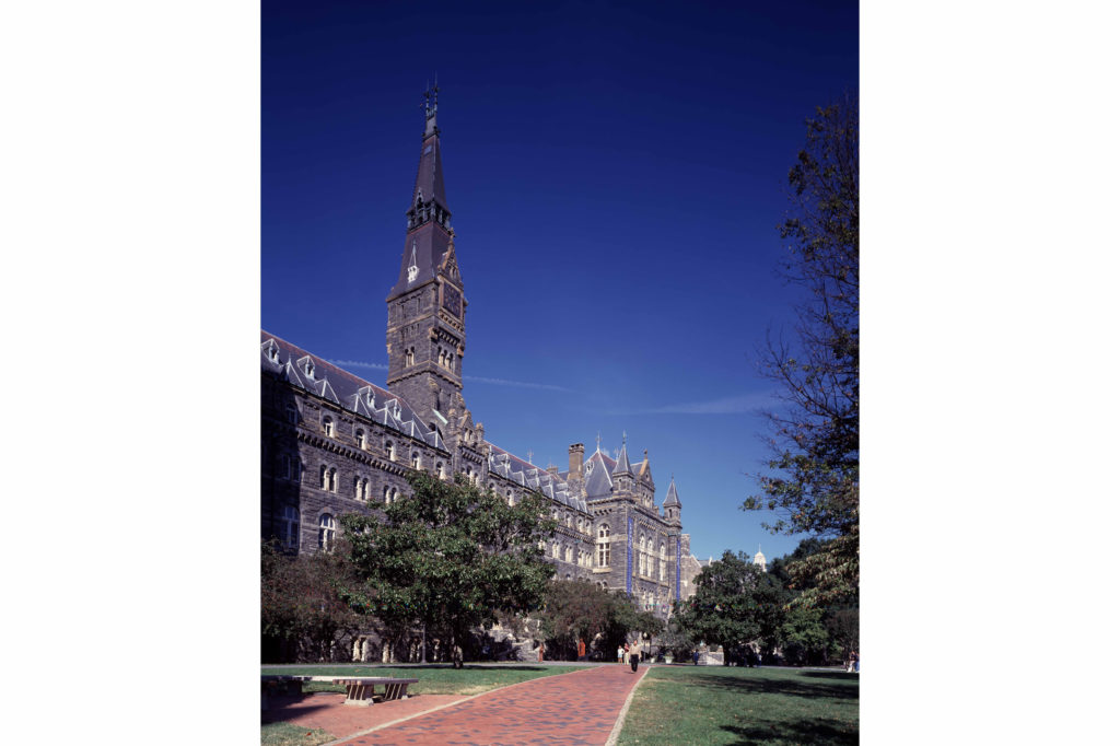 "Georgetown Univesity's flagship building, Healy Hall, named for its president, Patrick Francis Healy, at the time the building opened in 1879. It was once a student tradition to steal the clock tower's hands and mail them to the Vatican in Rome, which would stamp them ""return to sender"" and return them to the university. (Photo: Carol M. Highsmith / Wikimedia Commons)"