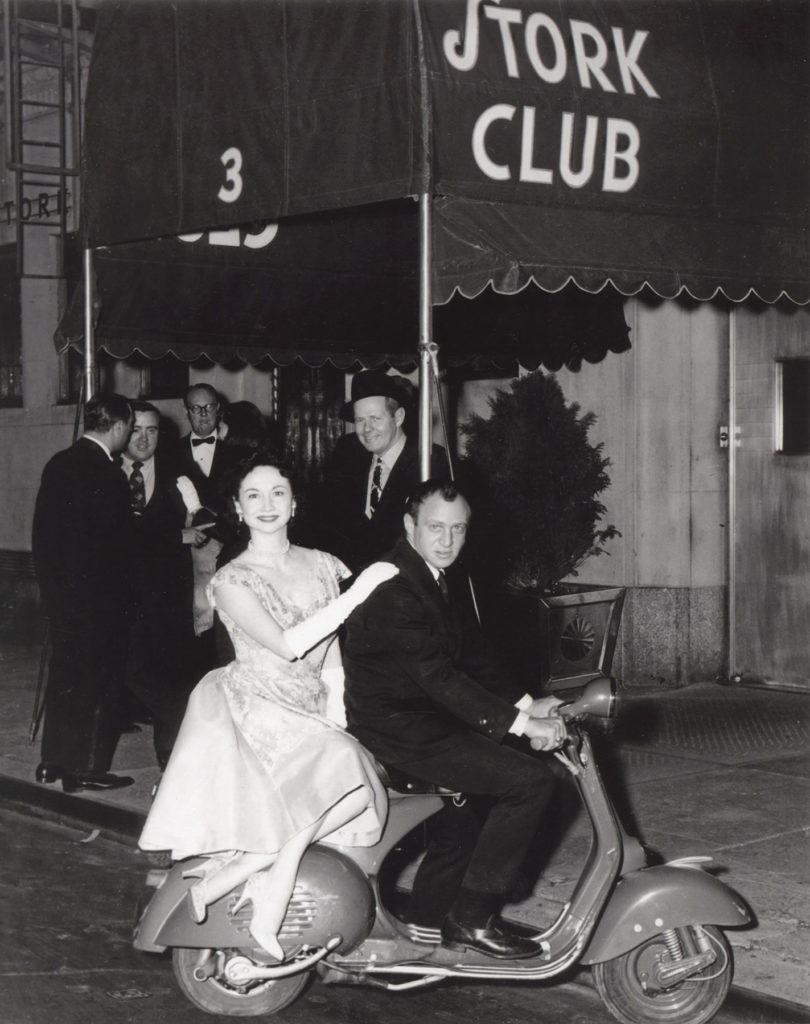 Dorothy and pal on a scooter outside the Stork Club.