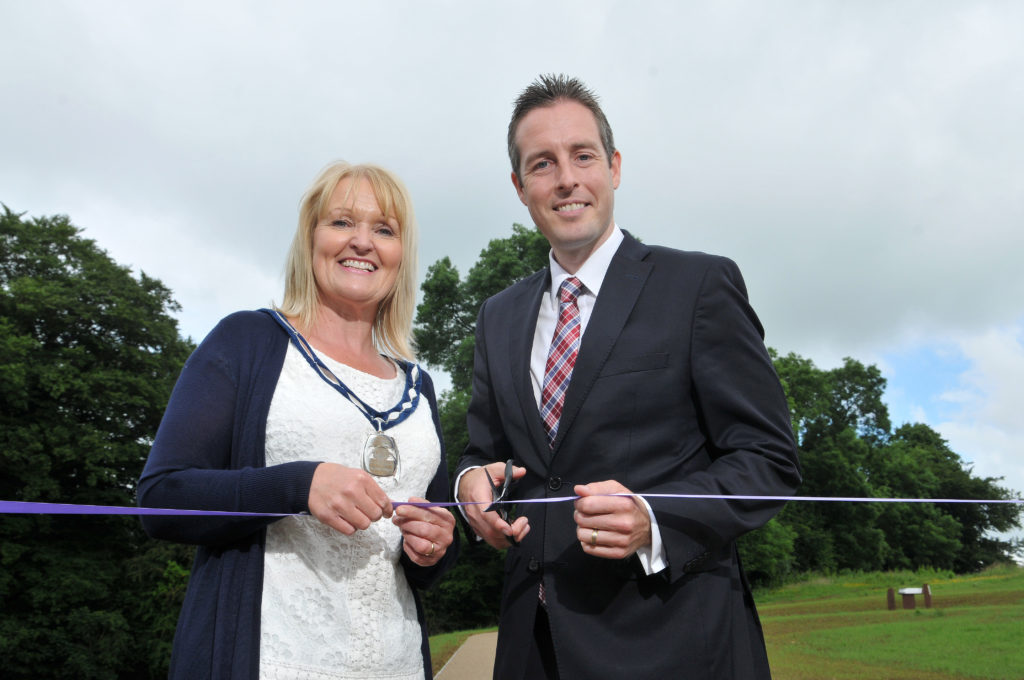 Minister for Communities Paul Givan MLA along with Sharon McAleer, Deputy Chair Mid Ulster Council at the re-opening of Tullaghoge Fort. (Photo: NorthernIreland.gov.uk)