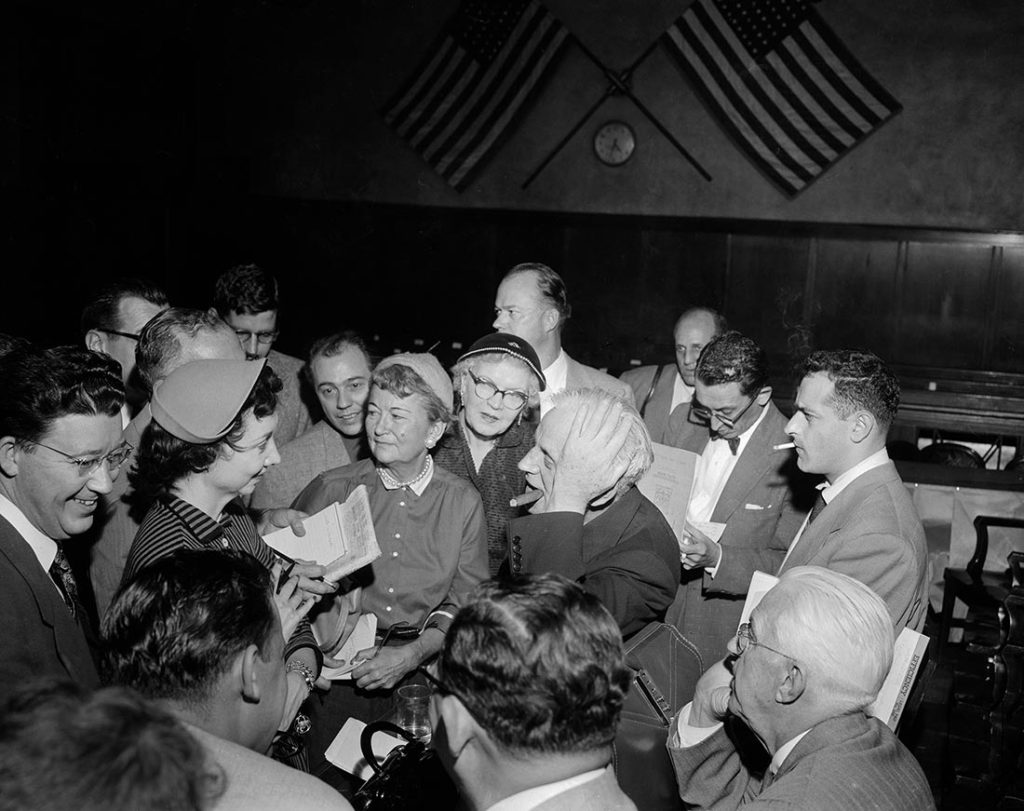 Dorothy flanked by fans during the trial of Sam  Sheppard.