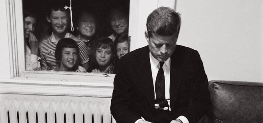 Senator John F. Kennedy checking over a speech during the Presidential campaign with some unexpected guests. (Photo: Paul Schutzer/The LIFE Picture Collection/Getty Images)