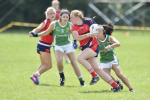 A Chicago St. Brigid's player flying by her Charlotte James Connolly's opponent.