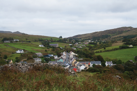 <em>View from the monastic site at the old church down to the village, looking east. The main road is seen as it leaves Kilcar in direction to Killybegs.</em>