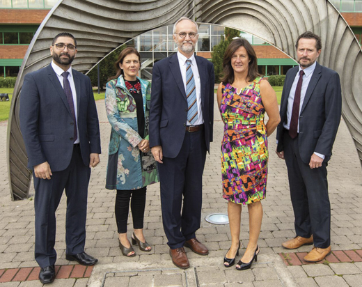 <em>PMTC Director Ahmed B. Albadarin (left) with colleagues.</em>
