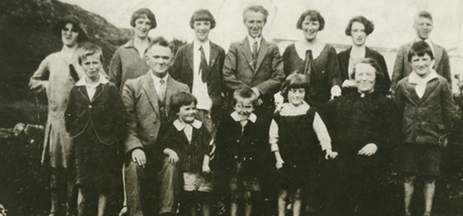 Back row, left.   Evelyn (born 1914), Anne (1913), Bridie (1908), Michael (1911), Mary (1905) Marguerite (1909), John (1916). Front row, left: Frank (1918), Michael O'Donnell (father), Leila (1925), Patrick (1924), Genevieve (1923), Margaret (Doogan) O'Donnell (mother), Philip (1920).