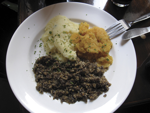 <em>A plate of mashed neeps, tatties and haggis.</em>