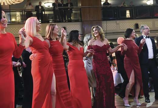 "<em>Ladies dance along as Chris de Burgh sings his famous hit song ""The Lady in Red.""</em>"
