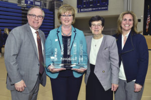 Eileen accepted the 2017-2018 Neumann University Institute for Sport, Spirituality and Character Development Award. Pictured: Dr. Chris Domes (President of Neumann University); Eileen McDonnell; County Sligo native Sr. Marguerite O'Beirne, OSF (VP for Mission and Ministry); and Lee Delle Monache (Director of Neumann's Institute).