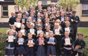 Students from Scoil Naomh Gobnait, Dungarvan, Waterford, show off their new books purchased with the Partnership grant.