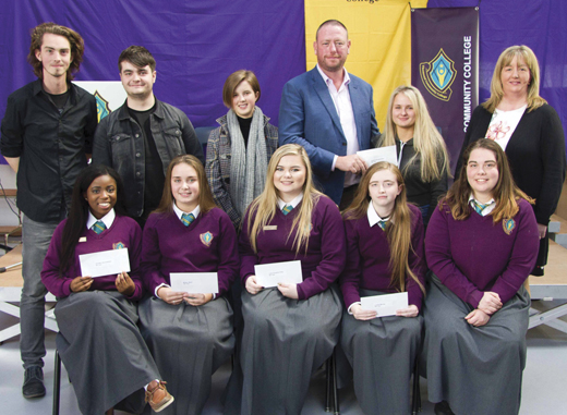 <em>Partnership board member Dave Greaney (pictured with students) gives back to his former secondary school, St. Nessan's (now known as Thomond Community College), by funding academic achievement awards for 20 students annually. </em>