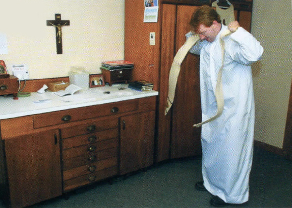 Fr. Michael Collins gets ready for mass.