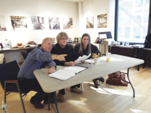 Ciarán O'Reilly, in the act of directing The Dead with Paul Muldoon and novelist Jean Hanff Korelitz, who had the idea to do James Joyce's short story as an immersive theater production.