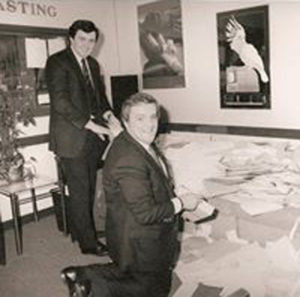 Adrian, pictured in his studio with Congressman Brian Donnelly, counting Donnelly visa applications.