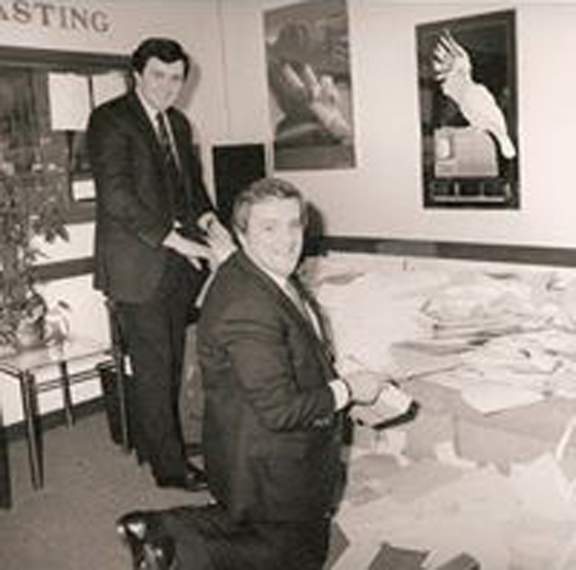 <em>Adrian, pictured in his studio with Congressman Brian Donnelly, counting Donnelly visa applications.</em>
