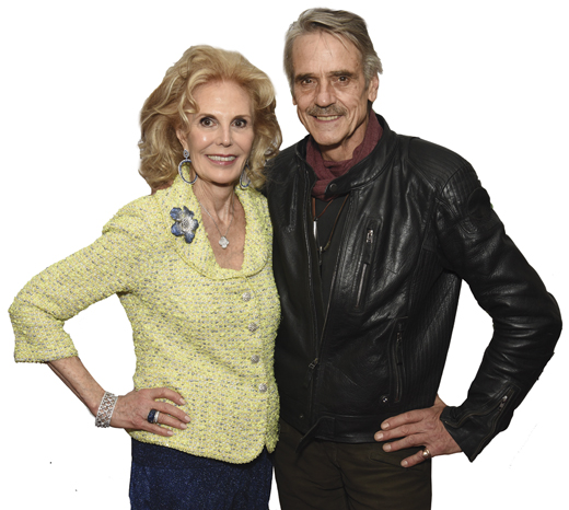 <em>Longtime supporter and 2018 gala honoree Tina Santi Flaherty, with Jeremy Irons, who participated in the stage production of songs by lyricist Alan Jay Lerner.</em>
