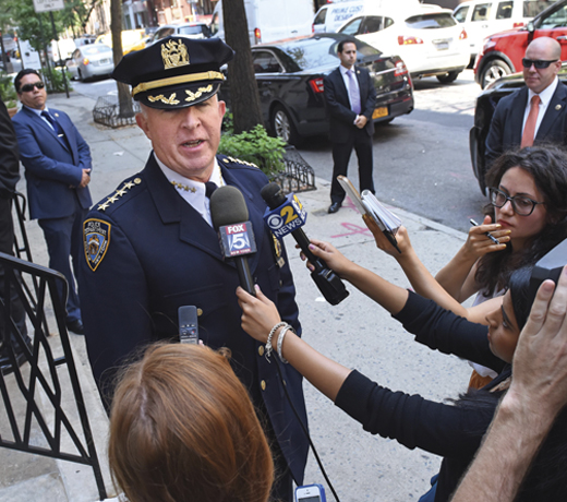 <em>An impromptu press conference on a New York City sidewalk in 2015, when O'Neill was chief of department.</em>