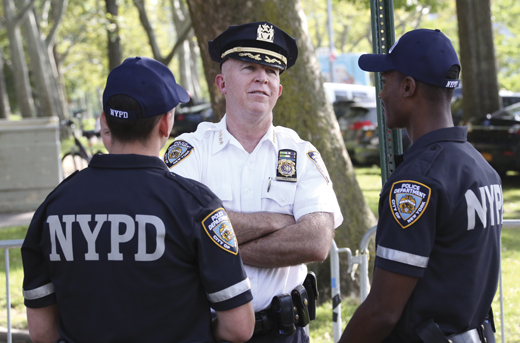 <em>O'Neill talks to officers during National Night Out Against Crime.</em>