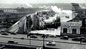 The SS Normandie lies on its side on the Hudson River after a fire aboard the ship.