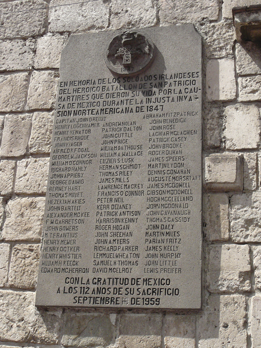 <em>Commemoration plaque to the Batallón de San Patricios, Placa en honor a los soldados irlandeses, who fought on the side of Mexico during the unjust American invasion of Mexico 1846-48. It lists 71 names of those captured, killed, or executed by the Americans in 1847. In all, 50 Saint Patrick's battalion members were officially executed by the U.S. Army. Collectively, this was the largest mass execution in United States history. The plaque is displayed on a wall of the Plaza San Jacinto, San Ángel quarter, Mexico City, and was erected in 1959 in gratitutde by the Mexican State.</em>