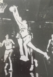 John Dearie drives around Dave DeBusschere for a Notre Dame basket. January 10, 1960. (Detroit Free Press).