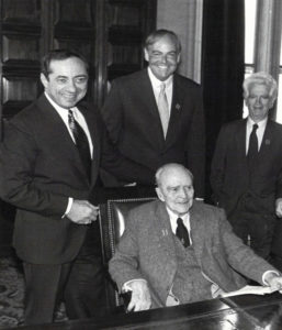 Albany introduces Dearie's bill, the MacBride Principles, signed into law later that year by Gov. Mario Cuomo (first in the nation). Clockwise from left: Gov. Cuomo, John Dearie, Paul O'Dwyer, and Sean MacBride. 1986.