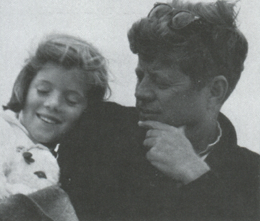 <em>JFK with his son John Jr. in Newport, Rhode Island in September 1963.</em>