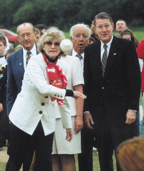 <em>Ambassador Jean Kennedy Smith pitching the first ball.</em>