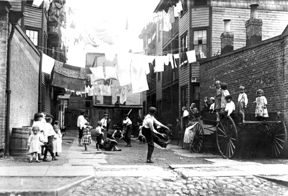 <em>Backyard playground used by Irish immigrant children, Boston, 1912.</em>