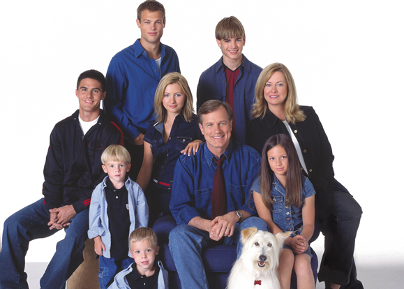 <em>Cast of <strong>7th Heaven</strong> Pictured (left to right back row): George Stults as Kevin, David Gallagher as Simon Camden, (middle row) Adam LaVorgna as Robbie Palmer, Beverly Mitchell as Lucy Camden, Catherine Hicks as Annie Camden, (bottom row) Lorenzo and Nicholas Brino as David and Sam Camden, Stephen Collins as Eric Camden, Mackenzie Rosman as Ruthie Camden, Happy the Dog as Happy. </em>