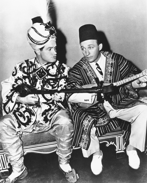 "<em>Crosby with his good friend, Bob Hope, in the <strong>Road to Morocco</strong> one of the many movies they made together, paving the way for all of the ""buddy"" films that followed.</em>"