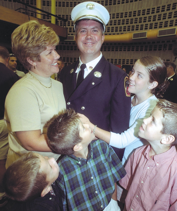 <em>Firefighter Timothy Stackpole, promoted to Captain with his family at a ceremony at Randall's Island FD, Left to right,front row: Terence,6; Brendan,9; Brian,10. Rear row; his wife Tara; daughter Kaitlyn, 15.</em>