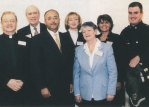 Honored by the Comptroller of the City of New York were (back row from left to right): James P. Murphy, Patricia Harty, Kathy E. Ryan, and police officer and Emerald Pipe Band member Andy McEnvoy. Front row left to right: Father Sean McManus, Comptroller William C. Thompson and Mary Nolan.