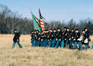 Irish Brigade reenactors retrace the steps of the 69th New York State Volunteers through the Wheatfield at Gettysburg on Remembrance Day, Nov. 2002 - photo by Jim Maher.
