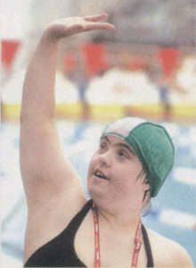 Irish athlete Brid Lynch celebrates winning a silver medal in the 400 meter freestyle Division 3 final.