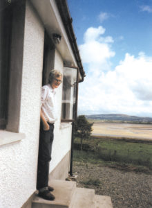 Paddy on the steps of his home overlooking the Isle of Doagh.